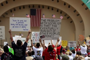 Some of the thousands of protestors gathered for the March 21st Tea Party in Orlando, FL. Photo credit: Peter Anderson/BigStockPhoto. Used with permission.